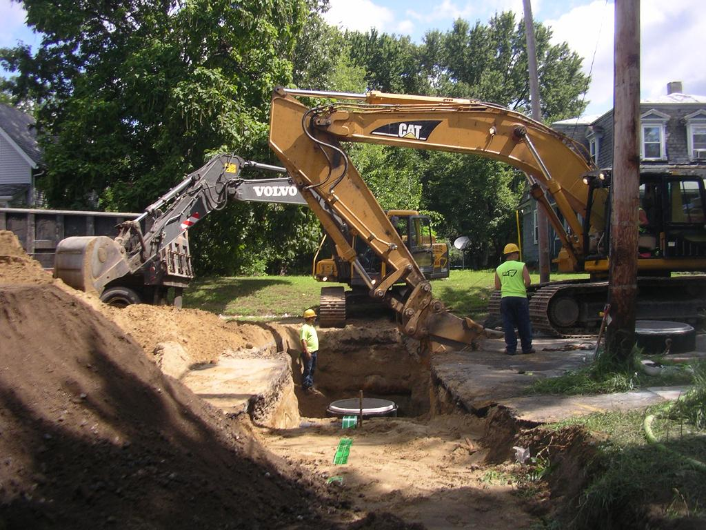 Excavation and laying of a new sewer pipe on East Street.