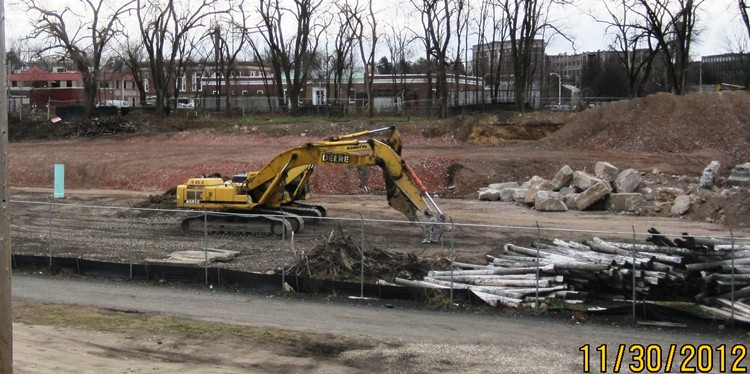 Excavator in demolition work area