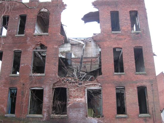 Old building with center of wall collapsed