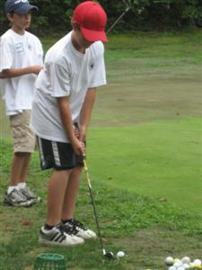 Golf camp participant preparing to take a swing