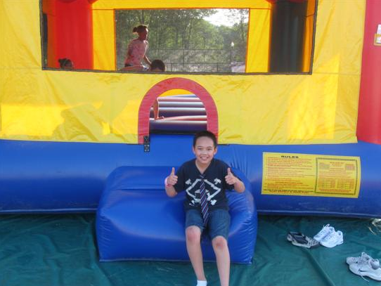 Enjoying a Bouncy Castle at the Relay