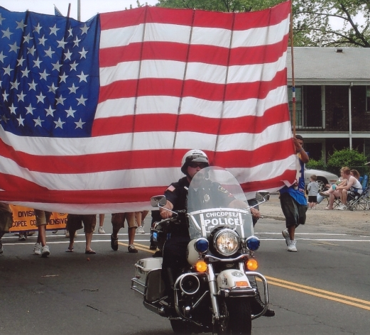 Motorcycle Officer in Front of U.S. Flag in a Parade