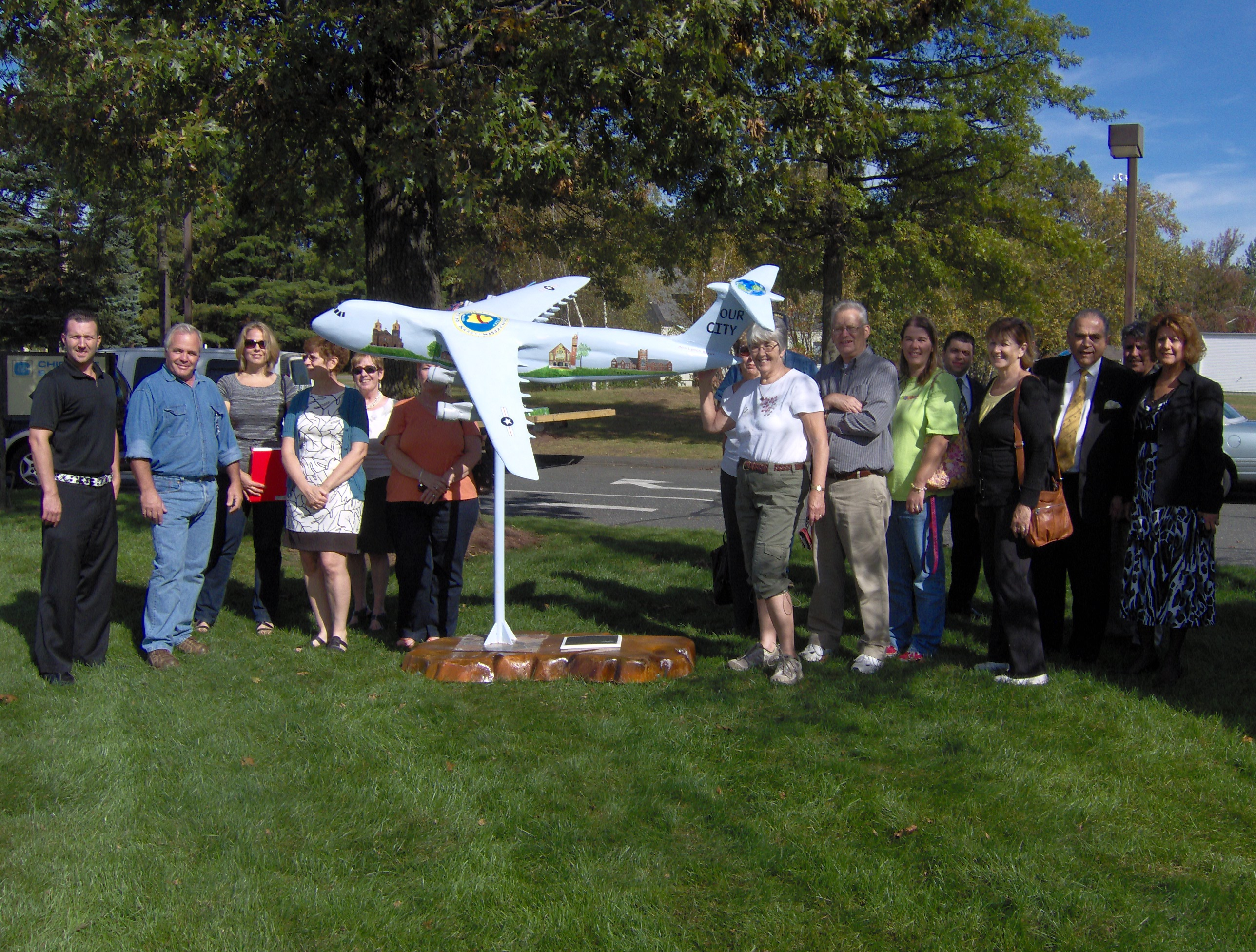 People gathered with Our City airplane model
